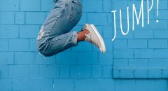 woman-blue-street-jumping-legs